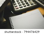 notepad on the desk | Shutterstock . vector #794476429