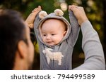 father playing with a cute...   Shutterstock . vector #794499589