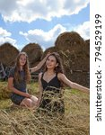 Small photo of Girls rest in the countryside, rest and vacations in nature