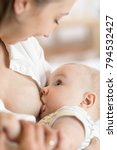 young mother holding her... | Shutterstock . vector #794532427
