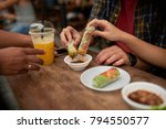 friends dipping spring rolls...   Shutterstock . vector #794550577