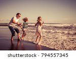 father and children playing on... | Shutterstock . vector #794557345