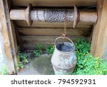 old bucket on a chain  used for ... | Shutterstock . vector #794592931