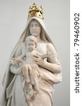 Stone Statue Of Madonna With...