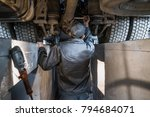 the man looks at the lorry in... | Shutterstock . vector #794684071