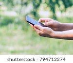 phone in female hands in... | Shutterstock . vector #794712274