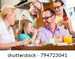 family in their home having... | Shutterstock . vector #794723041