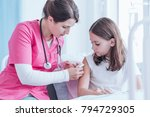 Nurse In Pink Uniform Giving A...