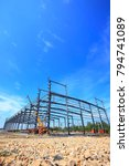 Small photo of Construction site, steel frame structure is under construction