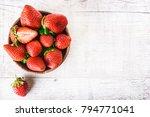 strawberries in wooden bowl on... | Shutterstock . vector #794771041