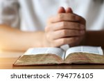 woman reading holy bible. | Shutterstock . vector #794776105