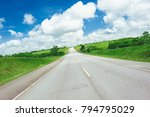 road crossing the forest with... | Shutterstock . vector #794795029