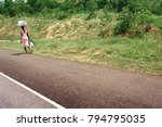road crossing the forest with... | Shutterstock . vector #794795035