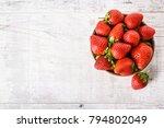 strawberries in wooden bowl.... | Shutterstock . vector #794802049