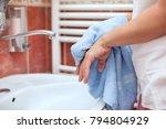 woman dry hands with towel in... | Shutterstock . vector #794804929