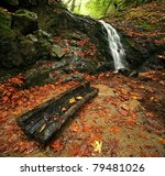 A Waterfall And Log In Autumn...