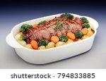 roast beef with vegetables in... | Shutterstock . vector #794833885