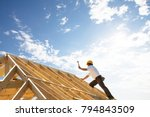 male roofer carpenter working... | Shutterstock . vector #794843509