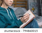 cropped image of girl sitting...   Shutterstock . vector #794860015