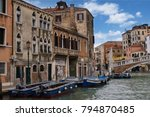 Small photo of Venice, Italy - 9 October 2013: beautiful typical view of the Venice canal with tourists passing over the bridge, on a fine sunny day with blue sky and clouds, charms and splendor of eternal city
