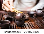 woman cleaning cup with boiled...   Shutterstock . vector #794876521