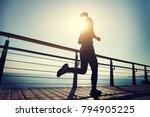 sporty female runner running on ... | Shutterstock . vector #794905225