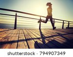 sporty fitness female runner... | Shutterstock . vector #794907349