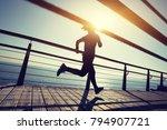sporty female runner running on ... | Shutterstock . vector #794907721