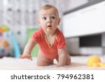 funny baby boy crawling on the... | Shutterstock . vector #794962381