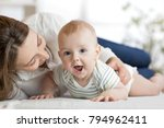 mom and child son lying down on ... | Shutterstock . vector #794962411