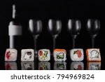 sushi on a dark background. | Shutterstock . vector #794969824