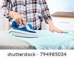 woman ironing laundry  indoors | Shutterstock . vector #794985034