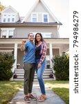portrait of couple holding keys ...   Shutterstock . vector #794986279