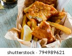 fish and chips in a paper... | Shutterstock . vector #794989621