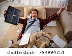 happy adult male lying in bed... | Shutterstock . vector #794994751