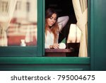 young fashion woman sitting at... | Shutterstock . vector #795004675