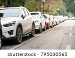 cars parked on the urban street ... | Shutterstock . vector #795030565