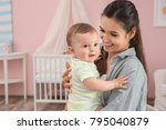 mother holding cute baby after... | Shutterstock . vector #795040879