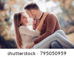 happy young couple having fun... | Shutterstock . vector #795050959