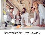 team of young engineers working ... | Shutterstock . vector #795056359
