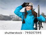 woman carrying skis | Shutterstock . vector #795057595