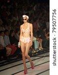 Small photo of CANARY ISLANDS - 18 JUNE: Model on the catwalk wearing bikini from designer Nuria Diaz, Calima Swimwear, during Moda Calida in Maspalomas June 18, 2011 in Canary Islands, Spain