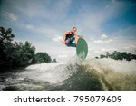 sporting wakeboarder rides up... | Shutterstock . vector #795079609