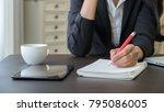 woman working paper work... | Shutterstock . vector #795086005