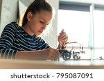 young girl working on school... | Shutterstock . vector #795087091