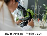 Small photo of Scientist doing research on plants