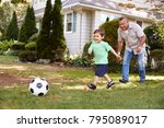 grandfather playing soccer in... | Shutterstock . vector #795089017