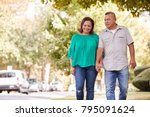 senior couple walking along... | Shutterstock . vector #795091624