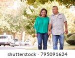 senior couple walking along... | Shutterstock . vector #795091624