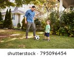 father playing soccer in garden ... | Shutterstock . vector #795096454